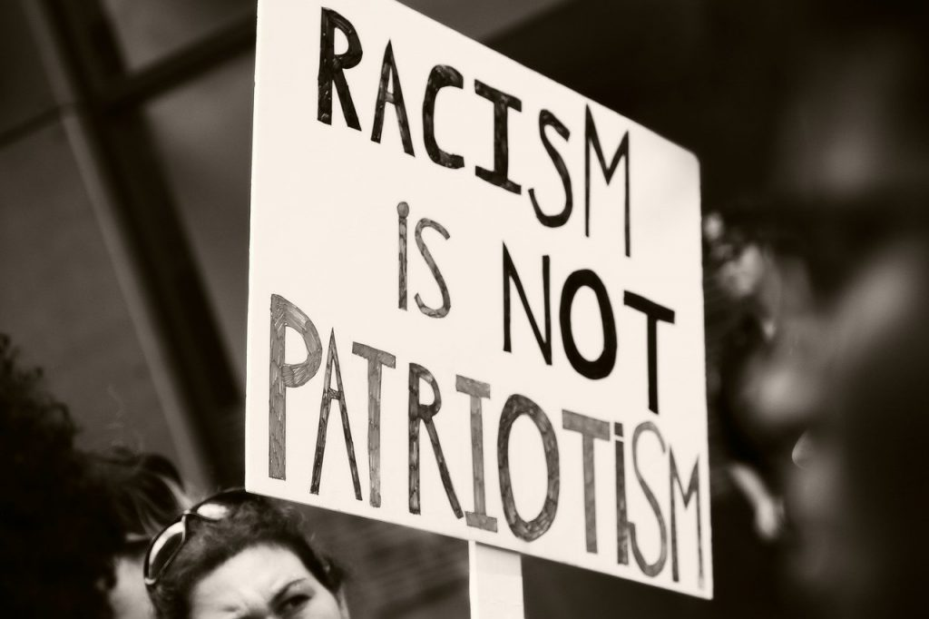 protest-sign-racism-is-not-patriotism